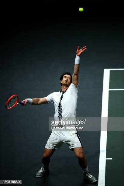 Andy Murray of Great Britain serves in his match against Andrey Rublev of Russiaduring Day 3 of the 48th ABN AMRO World Tennis Tournament at Ahoy on...