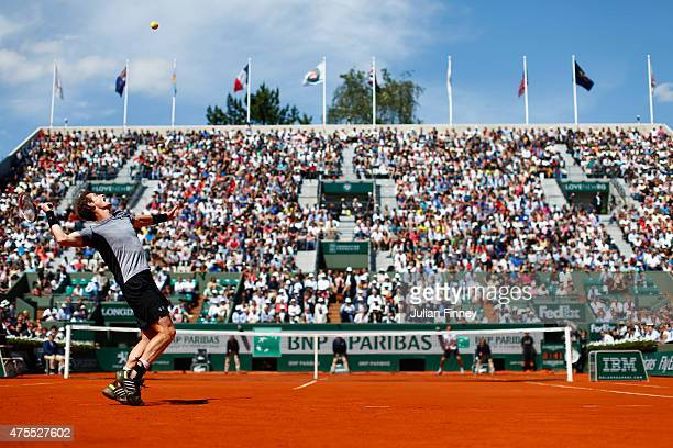 Andy Murray of Great Britain serves in his Men's Singles match against Jeremy Chardy of France on day nine of the 2015 French Open at Roland Garros...