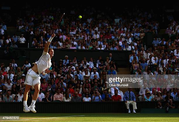 Andy Murray of Great Britain serves in his Mens Singles Third Round match against Andreas Seppi of Italy during day six of the Wimbledon Lawn Tennis...
