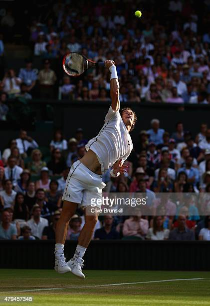 Andy Murray of Great Britain serves in his Mens Singles Third Round match against Andreas Seppi during day six of the Wimbledon Lawn Tennis...