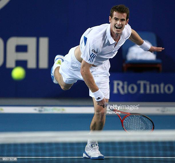 Andy Murray of Great Britain serves in his mixed doubles game, partnered by Laura Robson against Yaroslava Shvedova and Andrey Golubev of Kazakhstan...
