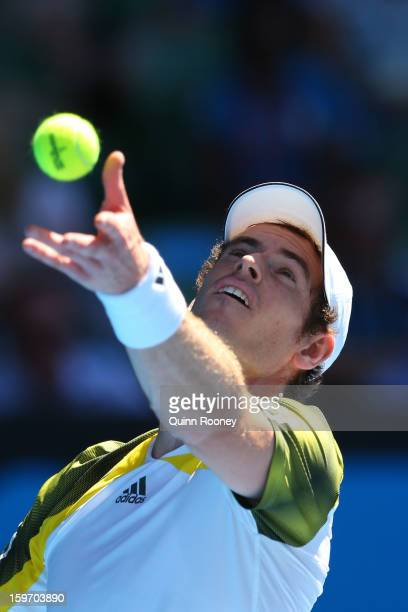 Andy Murray of Great Britain serves in his third round match against Ricardas Berankis of Lithuania during day six of the 2013 Australian Open at...