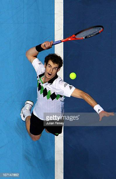 Andy Murray of Great Britain serves the ball during his men's singles match against David Ferrer of Spain during ATP World Tour Finals at O2 Arena on...