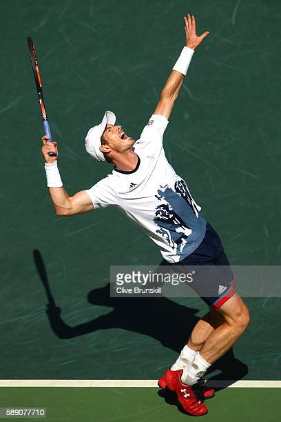 Andy Murray of Great Britain serves to Kei Nishikori of Japan during the Men's Singles Semifinal Match on Day 8 of the Rio 2016 Olympic Games at the...