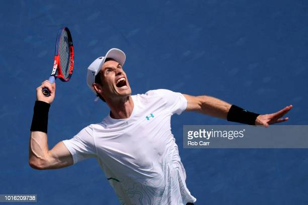 Andy Murray of Great Britain serves to Lucas Pouille of France during Day 3 of the Western and Southern Open at the Lindner Family Tennis Center on...