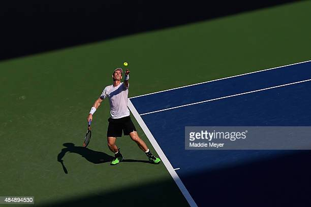 Andy Murray of Great Britain serves to Roger Federer of Switzerland during the semifinals on Day 8 of the Western Southern Open at the Lindner Family...