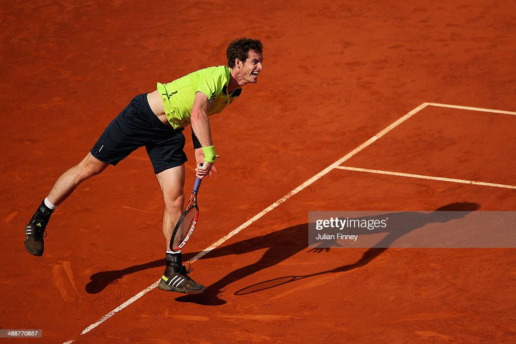 Andy Murray of Great Britain serves to Santiago Giraldo of Colombia during day six of the Mutua Madrid Open tennis tournament at the Caja Magica on May 8, 2014 in Madrid, Spain.