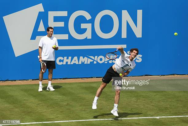 Andy Murray of Great Britain serves watched by coach Jonas Bjorkman during practice on day one of the Aegon Championships at Queen's Club on June 15,...