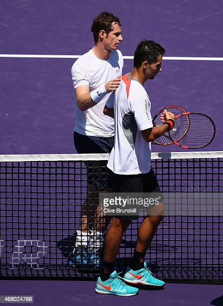Andy Murray of Great Britain shakes hands at the net after his straight sets victory against Santiago Giraldo of Columbia in their third round match...