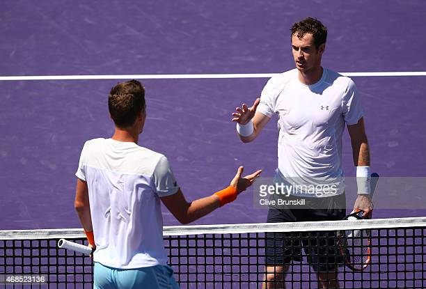 Andy Murray of Great Britain shakes hands at the net after his straight sets victory against Tomas Berdych of the Czech Republic in their semi-final...