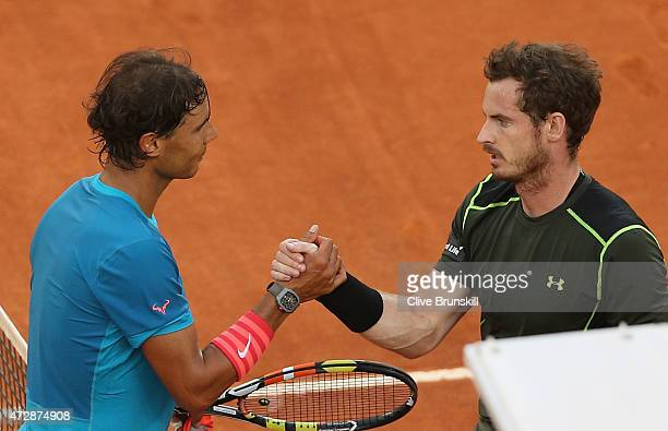 Andy Murray of Great Britain shakes hands at the net after his straight sets victory against Rafael Nadal of Spain in the mens final during day nine...