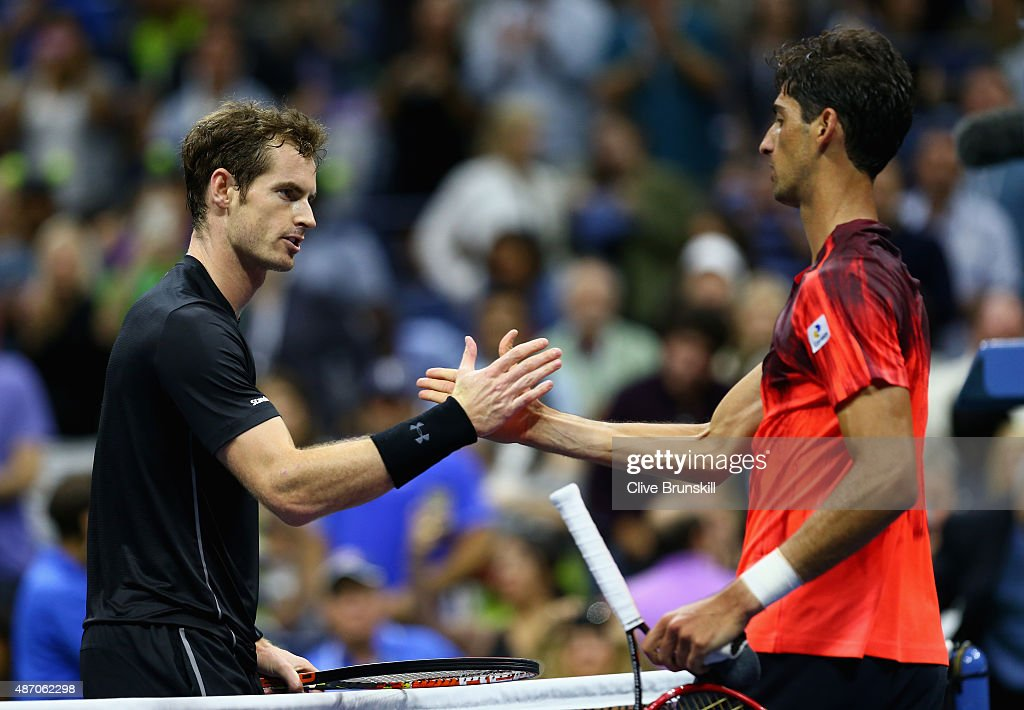Andy Murray of Great Britain shakes hands at the net after his straight sets victory against Thomaz Bellucci of Brazil during their mens singles third round match on Day Six of the 2015 US Open at the USTA Billie Jean King National Tennis Center on September 5, 2015 in the Flushing neighborhood of the Queens borough of New York City.