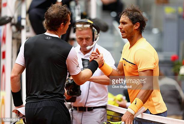 Andy Murray of Great Britain shakes hands at the net after his straight sets victory against Rafael Nadal of Spain in their semi final match during...