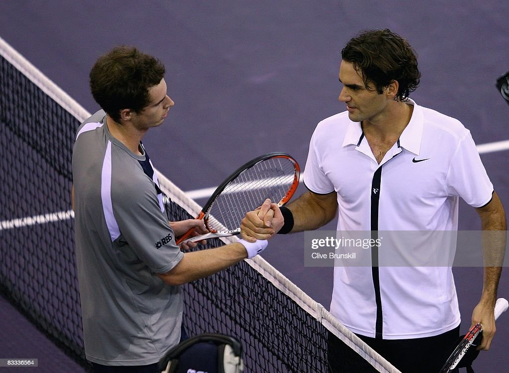 Andy Murray (L) of Great Britain shakes hands at the net after his three set victory against Roger Federer of Switzerland during their semi final match at the Madrid Masters tennis tournament at the Madrid Arena on October 18, 2008 in Madrid, Spain.