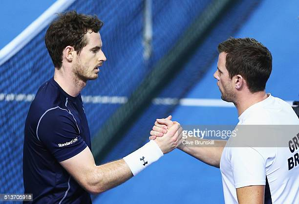 Andy Murray of Great Britain shakes hands with captain Leon Smith after defeating Taro Daniel of Japan in their singles match during day one of the...