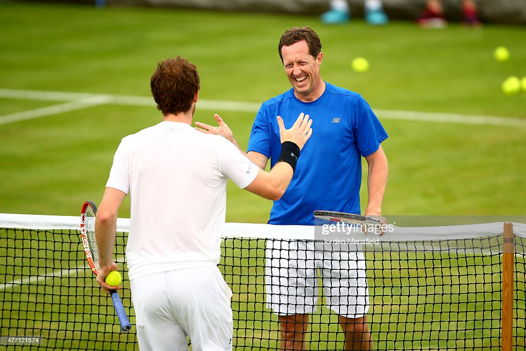 Andy Murray of Great Britain shakes hands with his coach Jonas Bjorkman of Sweden during a practice session ahead of the Aegon Championships at the Queens Club on June 14, 2015 in London, England.