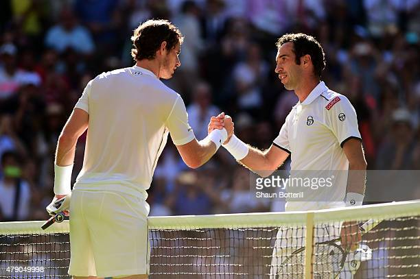 Andy Murray of Great Britain shakes hands with his opponent after winning his Gentlemen's Singles first round match against Mikhail Kukushkin of...
