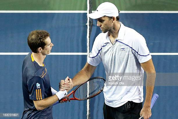 Andy Murray of Great Britain shakes hands with Ivo Karlovic of Croatia after winning his first round match during day two of the Rakuten Open at...