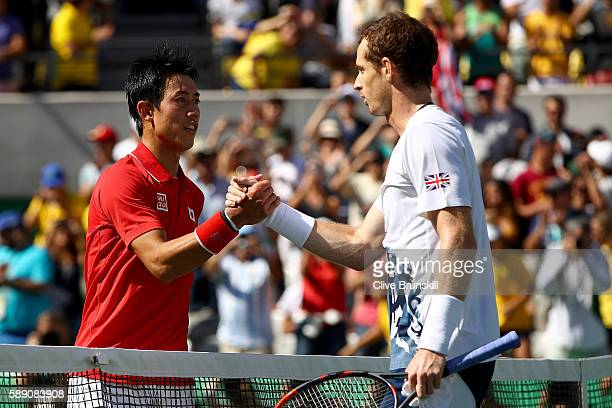 Andy Murray of Great Britain shakes hands with Kei Nishikori of Japan after their Men's Singles Semifinal Match on Day 8 of the Rio 2016 Olympic...