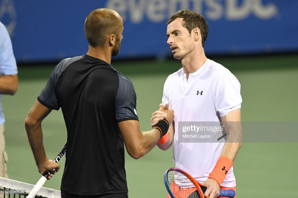 Andy Murray of Great Britain shakes hands with Marius Copil of Romania after winning their match during Day Six of the Citi Open at the Rock Creek Tennis Center on August 2, 2018 in Washington, DC.