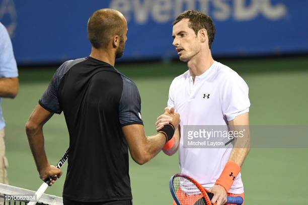 Andy Murray of Great Britain shakes hands with Marius Copil of Romania after winning their match during Day Six of the Citi Open at the Rock Creek...