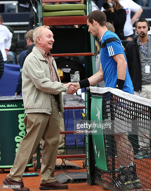 Andy Murray of Great Britain shakes hands with Rod Laver before his match against Donald Young of the United States during day one of the Davis Cup...