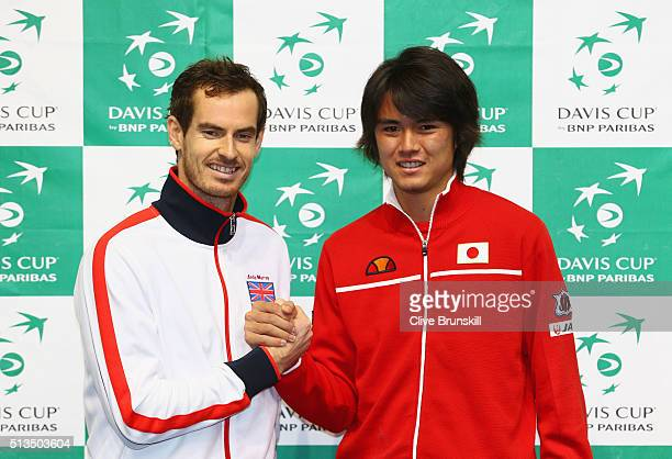 Andy Murray of Great Britain shakes hands with singles match opponent Taro Daniel of Japan ahead of the Davis Cup World Group 1st round tie between...