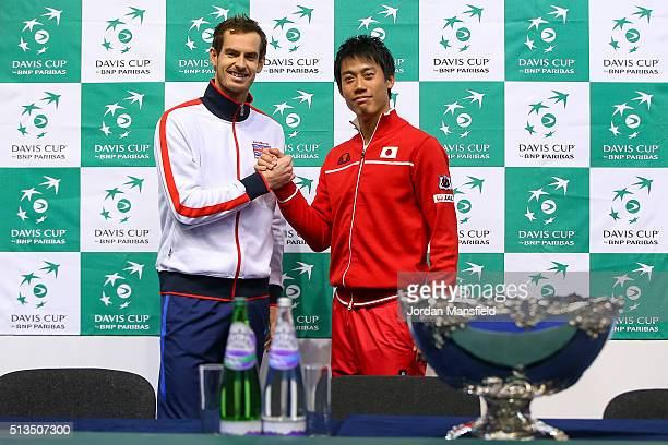 Andy Murray of Great Britain shakes hands with singles match opponent Kei Nishikori of Japan ahead of the Davis Cup World Group 1st round tie between...
