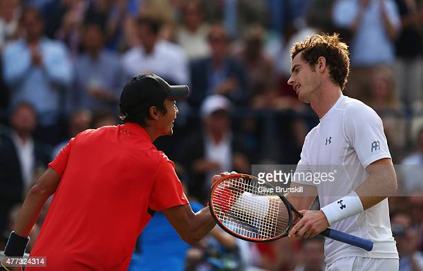 Andy Murray of Great Britain shakes hands with Yen-Hsun Lu of Chinese Taipei after their men's singles first round match during day two of the Aegon...