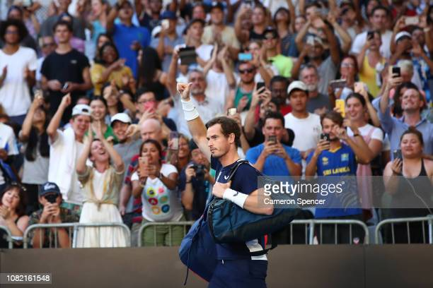 Andy Murray of Great Britain shows appreication to the fans as he walks onto the court prior to his first round match against Roberto Bautista Agut...