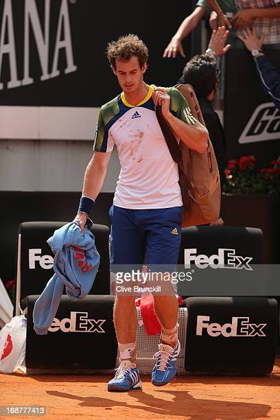 Andy Murray of Great Britain shows his dejection as he walks off court following his withdrawal due to injury at the end of the second set against...