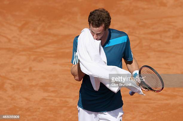 Andy Murray of Great Britain shows his dejection during his straight sets defeat in the fourth rubber by Fabio Fognini of Italy during day three of...