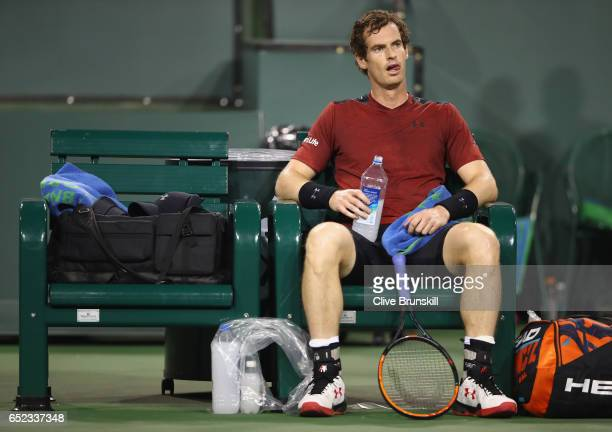 Andy Murray of Great Britain shows his dejection during his straight sets defeat by Vasek Pospisil of Canada in their second round match during day...