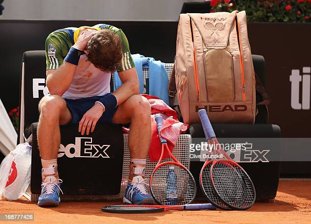Andy Murray of Great Britain shows his dejection following his withdrawal due to injury at the end of the second set against Marcel Granollers of...
