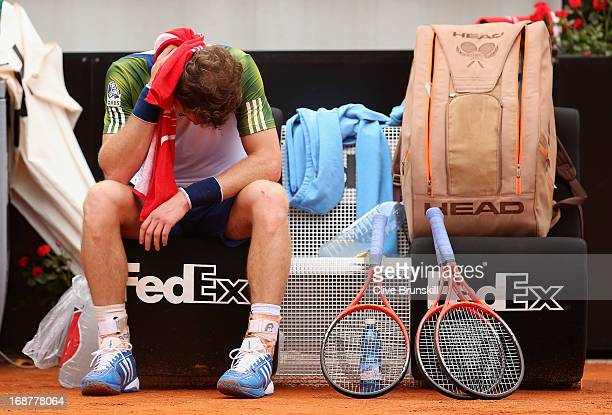 Andy Murray of Great Britain shows his dejection prior to taking an injury timeout against Marcel Granollers of Spain in their second round match...