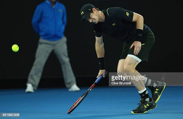 Andy Murray of Great Britain shows his discomfort as he trys to run for the ball after injuring his ankle after he fell over in his second round...