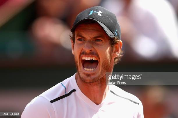 Andy Murray of Great Britain shows his emotions during the mens singles semifinal match against Stan Wawrinka of Switzerland on day thirteen of the...