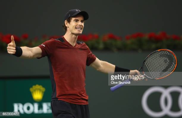 Andy Murray of Great Britain shows his frustration during his straight sets defeat by Vasek Pospisil of Canada in their second round match during day...