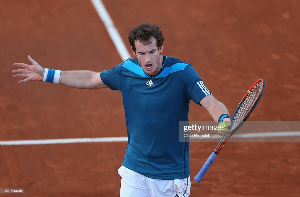 Andy Murray of Great Britain shows his frustrations against Andreas Seppi of Italy during day one of the Davis Cup World Group Quarter Final match between Italy and Great Britain at Tennis Club Napoli on April 4, 2014 in Naples, Italy.
