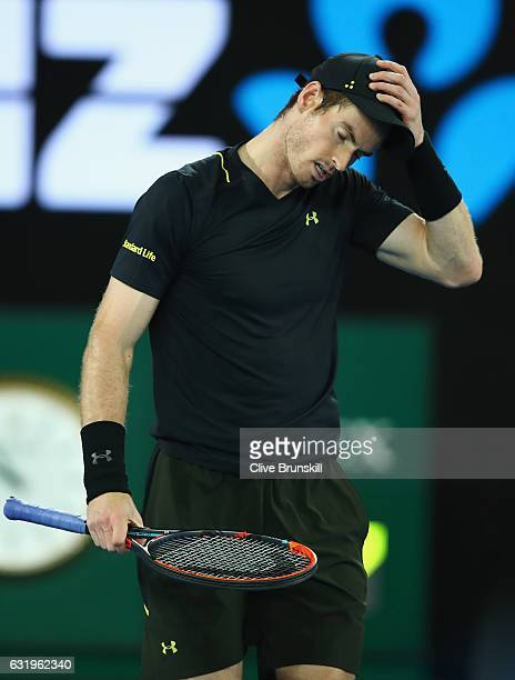 Andy Murray of Great Britain shows his relief on match point after injuring his ankle after he fell over in his second round match against Andrey...