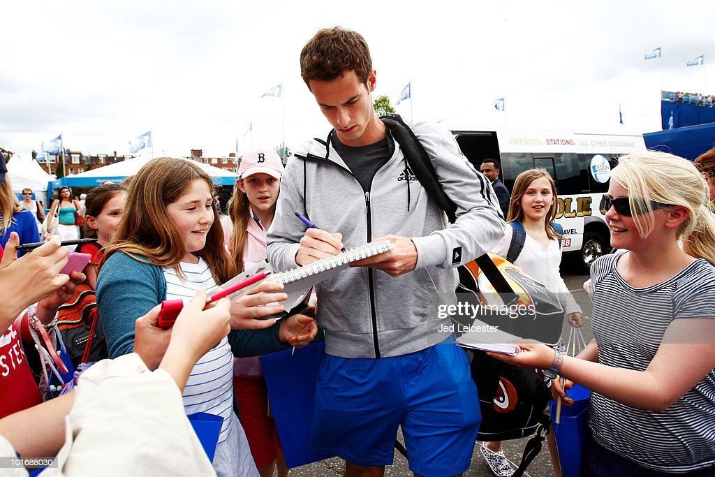 Andy Murray of Great Britain signs autographs as he arrives during Day 1 of the the AEGON Championships at Queen's Club on June 7, 2010 in London, England.