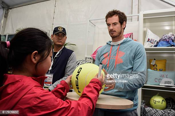 Andy Murray of Great Britain signs autographs at the Offical Merchandise Booth on day six of the 2016 China Open at the China National Tennis Centre...