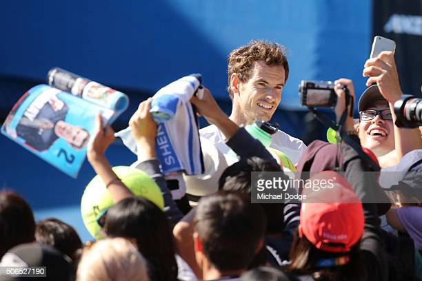 Andy Murray of Great Britain signs autographs for fans after his practice session during day seven of the 2016 Australian Open at Melbourne Park on...