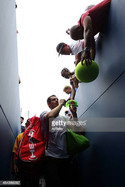 Andy Murray of Great Britain signs his autograph for fans after defeating Andrey Kuznetsov of Russia in their men's singles third round match on Day...