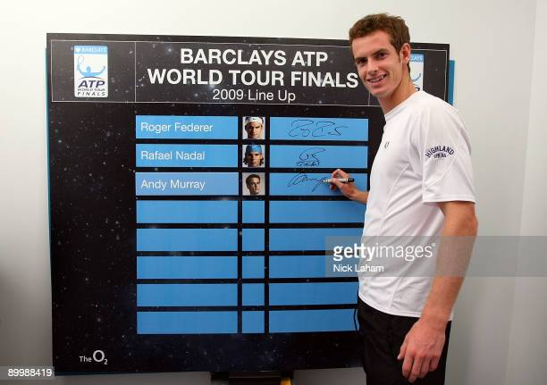 Andy Murray of Great Britain signs the Barclays ATP World Tour Finals leader board after qualifying for the eightman event held at The O2 in London...