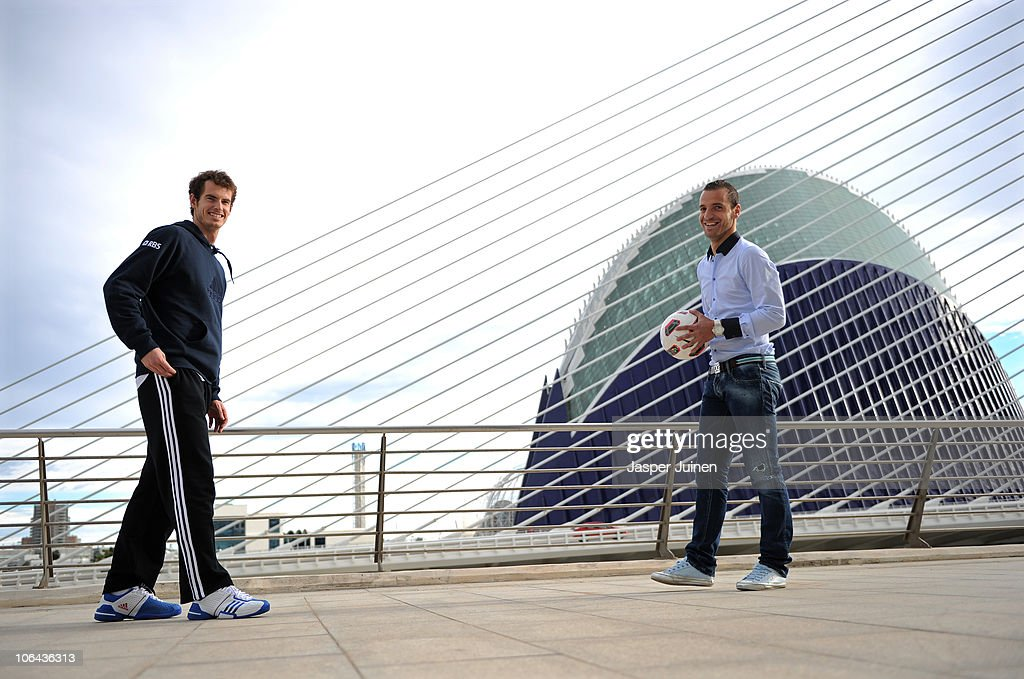 Andy Murray (L) of Great Britain smiles alongside football player Roberto Soldado of Valencia during the ATP 500 World Tour Valencia Open tennis tournament at the Ciudad de las Artes y las Ciencias on November 1, 2010 in Valencia, Spain.