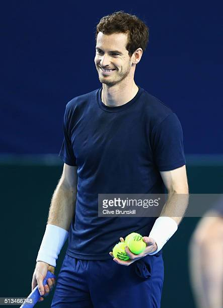 Andy Murray of Great Britain smiles during a Great Britain practice session ahead of their Davis Cup World Group 1st round tie against Japan at...