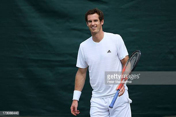 Andy Murray of Great Britain smiles during a practice session on day twelve of the Wimbledon Lawn Tennis Championships at the All England Lawn Tennis...