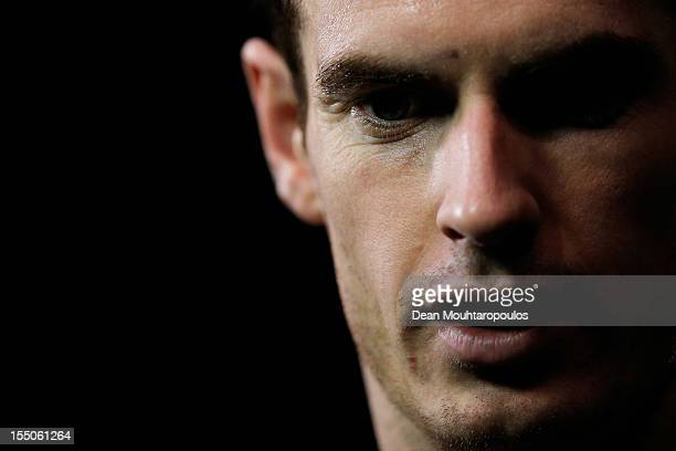 Andy Murray of Great Britain speaks to the media after victory against Paul Henri Mathieu of France during day 3 of the BNP Paribas Masters at Palais...