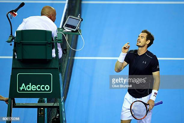 Andy Murray of Great Britain speaks with chair umpire Pascal Maria during his singles match against Juan Martin del Potro of Argentina on day one of...
